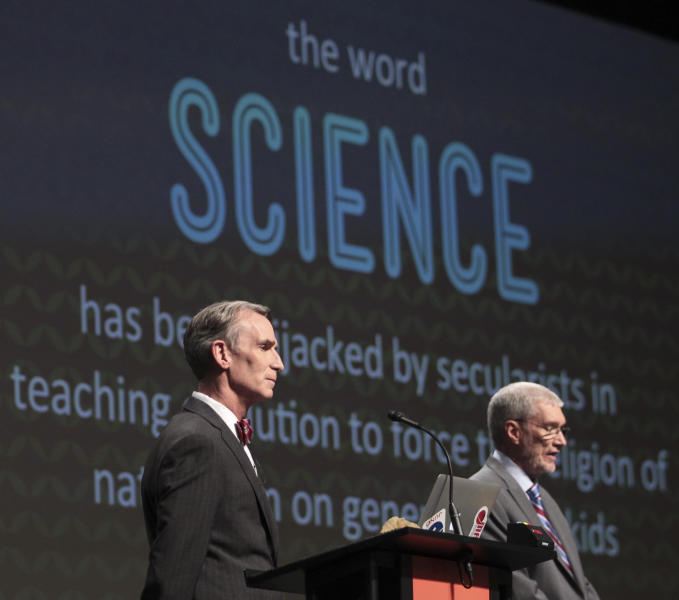"""FILE - In this Feb. 4, 2014 photo, Creation Museum head Ken Ham, right, speaks during a debate on evolution with TV's """"Science Guy"""" Bill Nye, at the Creation Museum in Petersburg, Ky. Ham says fundraising after the widely watched event helped to revive stalled plans to build a 510-foot replica of Noah's Ark. (AP Photo/The Courier-Journal, Matt Stone, File) NO SALES; MAGS OUT; NO ARCHIVE; MANDATORY CREDIT"""