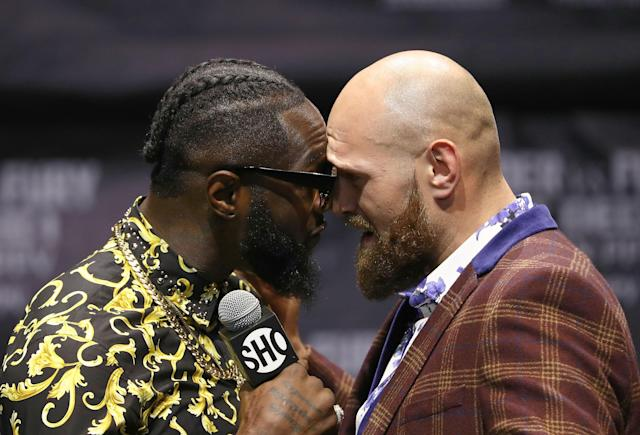 Deontay Wilder (L) and Tyson Fury butt heads onstage during a press conference to promote their upcoming Dec.1, 2018 fight in Los Angeles at The Novo by Microsoft on Oct. 3, 2018 in L.A. (Getty Images)