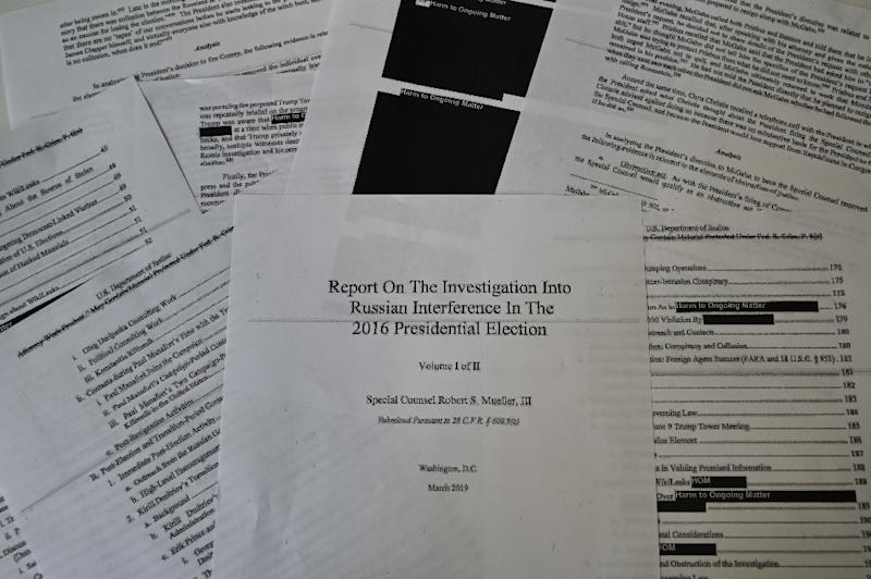 The redactions in the Mueller report hide information related to numerous still-ongoing investigations (AFP Photo/Eva HAMBACH)