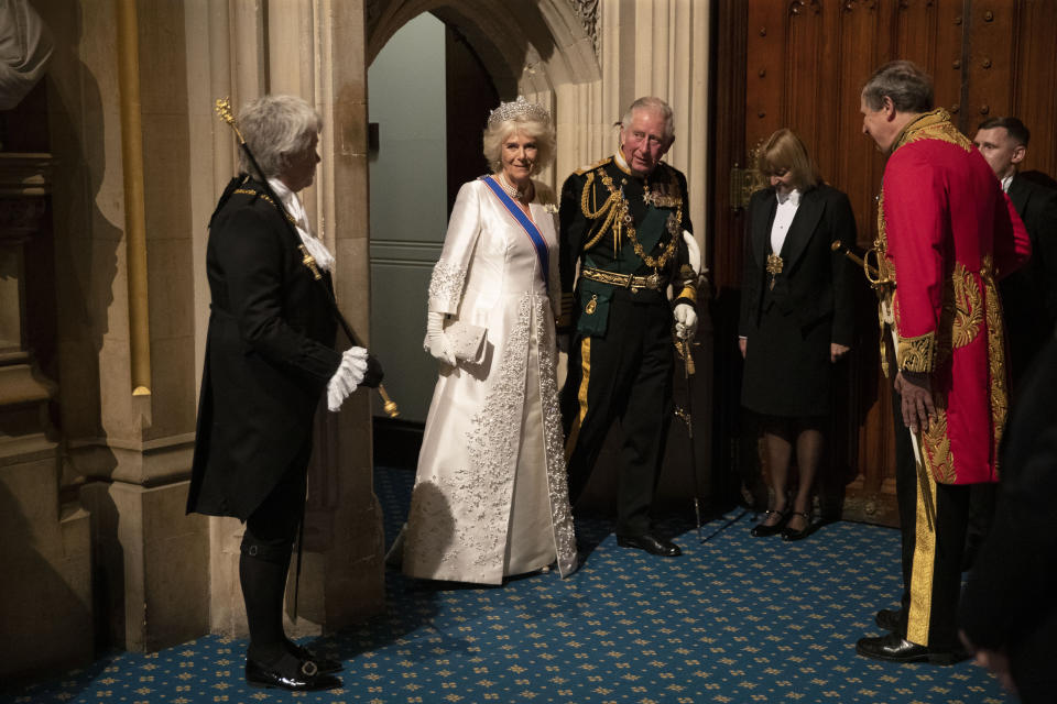 FILE - In this Monday, Oct. 14, 2019 file photo, Britain's Prince Charles, third left, and his wife Camilla the Duchess of Cornwall, second left, arrive in the Norman Porch, flanked at left by Black Rod, Sarah Clarke the first ever female to serve in the role of Black Rod, at the Palace of Westminster and the Houses of Parliament for the State Opening of Parliament ceremony in London. Prince Philip was the longest serving royal consort in British history. In Britain, the husband or wife of the monarch is known as consort, a position that carries immense prestige but has no constitutional role. The wife of King George VI, who outlived him by 50 years, was loved as the Queen Mother. Prince Charles' wife, Camilla, has worked to emerge from the shadow of his immensely popular first wife, Diana. (AP Photo/Matt Dunham, Pool, File)