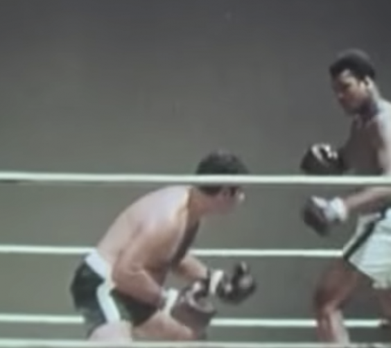 Muhammad Ali and Rocky Marciano act out their fight in the gym (YouTube)