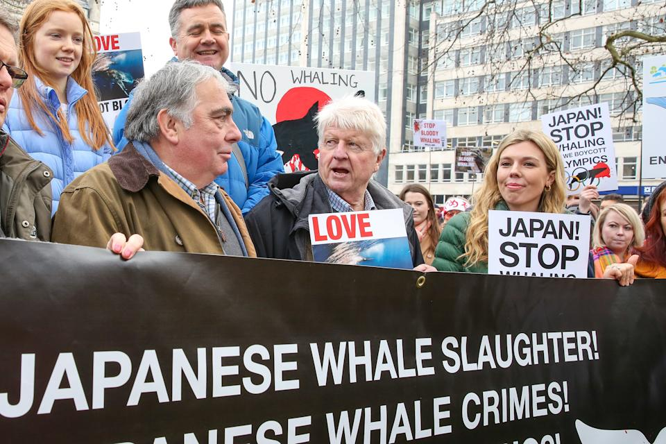 LONDON, UNITED KINGDOM - 2019/01/26: Former Foreign Secretary Boris Johnson's girlfriend Carrie Symonds (R) with Boris Johnson's father Stanley Johnson (C) are seen holding placards during the protest against Japanese Whaling in central London. (Photo by Dinendra Haria/SOPA Images/LightRocket via Getty Images)