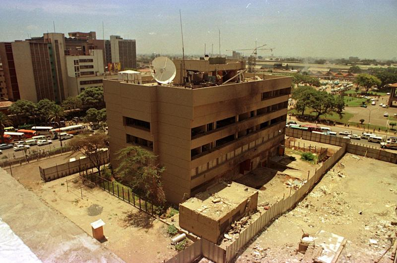 """FILE In this file photo of Monday, March 22,1999, The U.S. Embassy in downtown Nairobi, Kenya is seen. The embassy, which is scheduled for demolition, is to be replaced by a memorial garden in honor of the victims of the Aug. 7, 1998 bombing. As President Barack Obama prepares to visit East Africa nearly 15 years after terrorists bombed two U.S. embassies here, a former United States ambassador to Kenya says he worries that security at the Nairobi embassy has been """"complacent"""" and may not have had adequate priority in the recent past. Obama is scheduled on Monday, July 1, 2013, to visit Dar es Salaam, the commercial capital of Tanzania, which along with Nairobi was the site of near-simultaneous embassy attacks in August 1998. The attacks killed 224 people, mostly Kenyans, but also a dozen Americans. Obama is likely to visit the memorial for the victims of the Tanzania attack. (AP Photo/Khalil Senosi, File)"""
