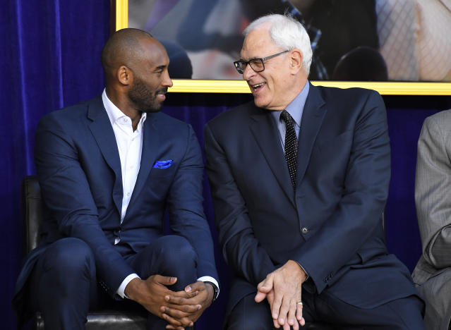 Kobe Bryant and Phil Jackson sat next to each other at Shaquille O'Neal's statue unveiling in March. (AP)