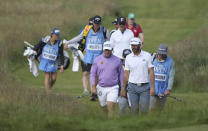 England's Lee Westwood, front left gestures talks to United States' Dustin Johnson on the 16th fairway during a practice round for the British Open Golf Championship at Royal St George's golf course Sandwich, England, Tuesday, July 13, 2021. The Open starts Thursday, July, 15. (AP Photo/Ian Walton)
