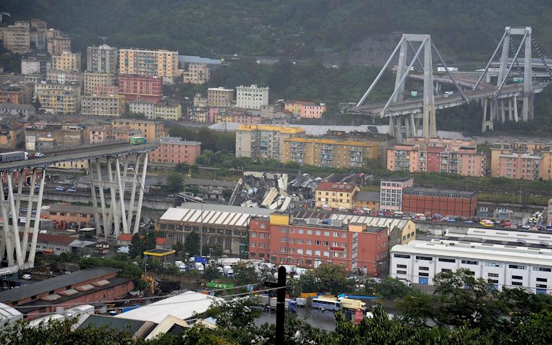 The collapsed Morandi Bridge is seen in the Italian port city of Genoa - REUTERS