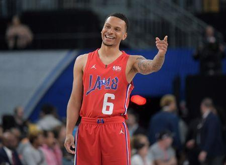 Feb 16, 2018; Los Angeles, CA, USA; Canadian sprinter Andre De Grasse reacts during the NBA All-Star Celebrity Game at the Los Angeles Convention Center. Mandatory Credit: Kirby Lee-USA TODAY Sports