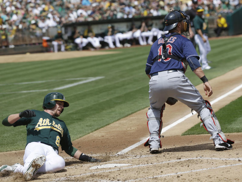 Young, Callaspo homer as A's beat Indians 7-3
