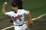 """FILE - In this July 8, 1997, file photo, Baltimore Orioles' Cal Ripken barehands a grounder from Atlanta Braves' Jeff Blauser for an out during the fifth inning of the All-Star baseball game in Cleveland. In all, 19 current Hall of Famers, and a few others who will one day be immortalized in Cooperstown were on the 1997 All-Star rosters. """"That's why I was on the bench,"""" Sandy Alomar Jr. said. (AP Photo/Ed Reinke, File)"""