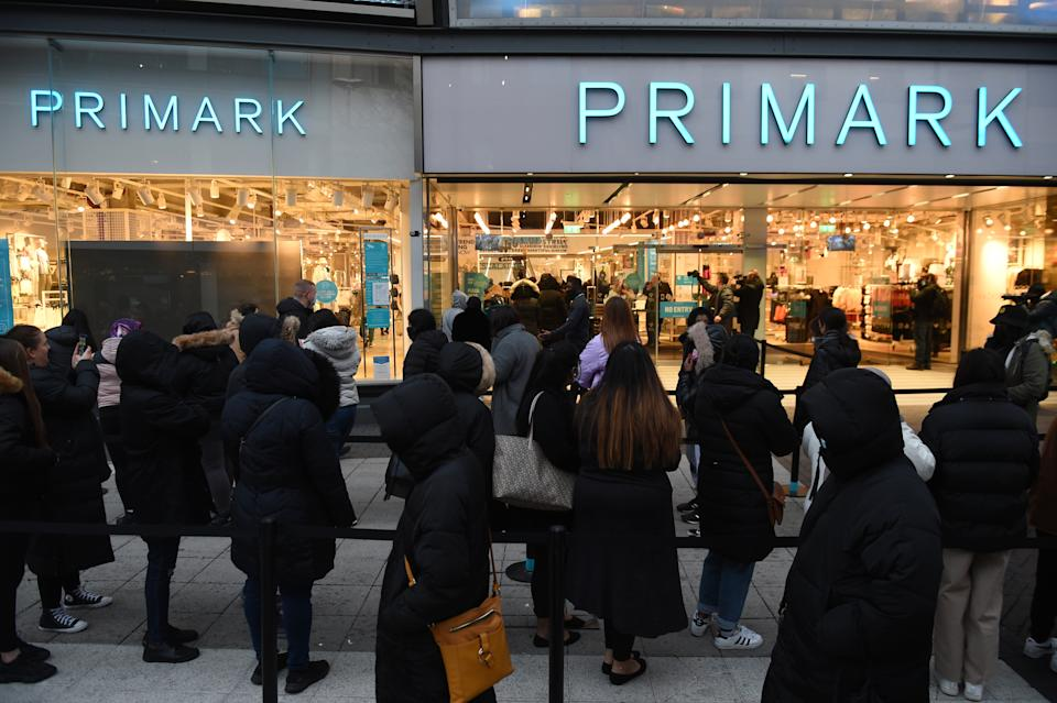 Early morning shoppers stand in line outside Primark, Birmingham, waiting for the store to reopen as England takes another step back towards normality with the further easing of lockdown restrictions. Picture date: Monday April 12, 2021.