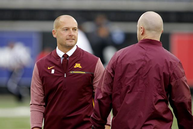 Minnesota head coach P.J. Fleck, left, before an NCAA college football game against Oregon State, in Corvallis, Ore., Saturday, Sept. 9, 2017. (AP Photo/Timothy J. Gonzalez)