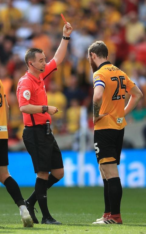Match referee Ross Joyce shows a red card to Newport County's Mark O'Brien - Credit: PA