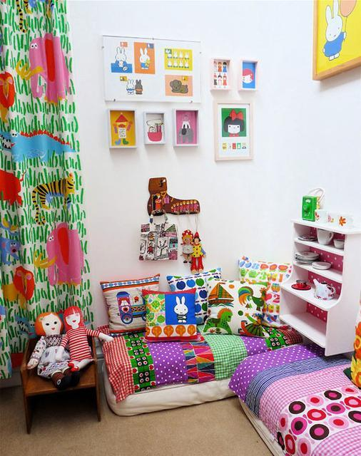 """<div class=""""caption-credit""""> Photo by: Apartment Therapy</div><div class=""""caption-title"""">Filled With Color</div>On the opposite end of an all-white room is this vibrant and colorful reading space. To match your kid's personality and comfort levels, splashing a rainbow in a the corner may help rev up the excitement for story time! <br> <i><a rel=""""nofollow noopener"""" href=""""http://blogs.babble.com/family-style/2012/08/13/25-cute-and-cozy-kids-reading-nooks/#filled-with-color"""" target=""""_blank"""" data-ylk=""""slk:Get the inspiration here"""" class=""""link rapid-noclick-resp"""">Get the inspiration here</a></i> <br>"""