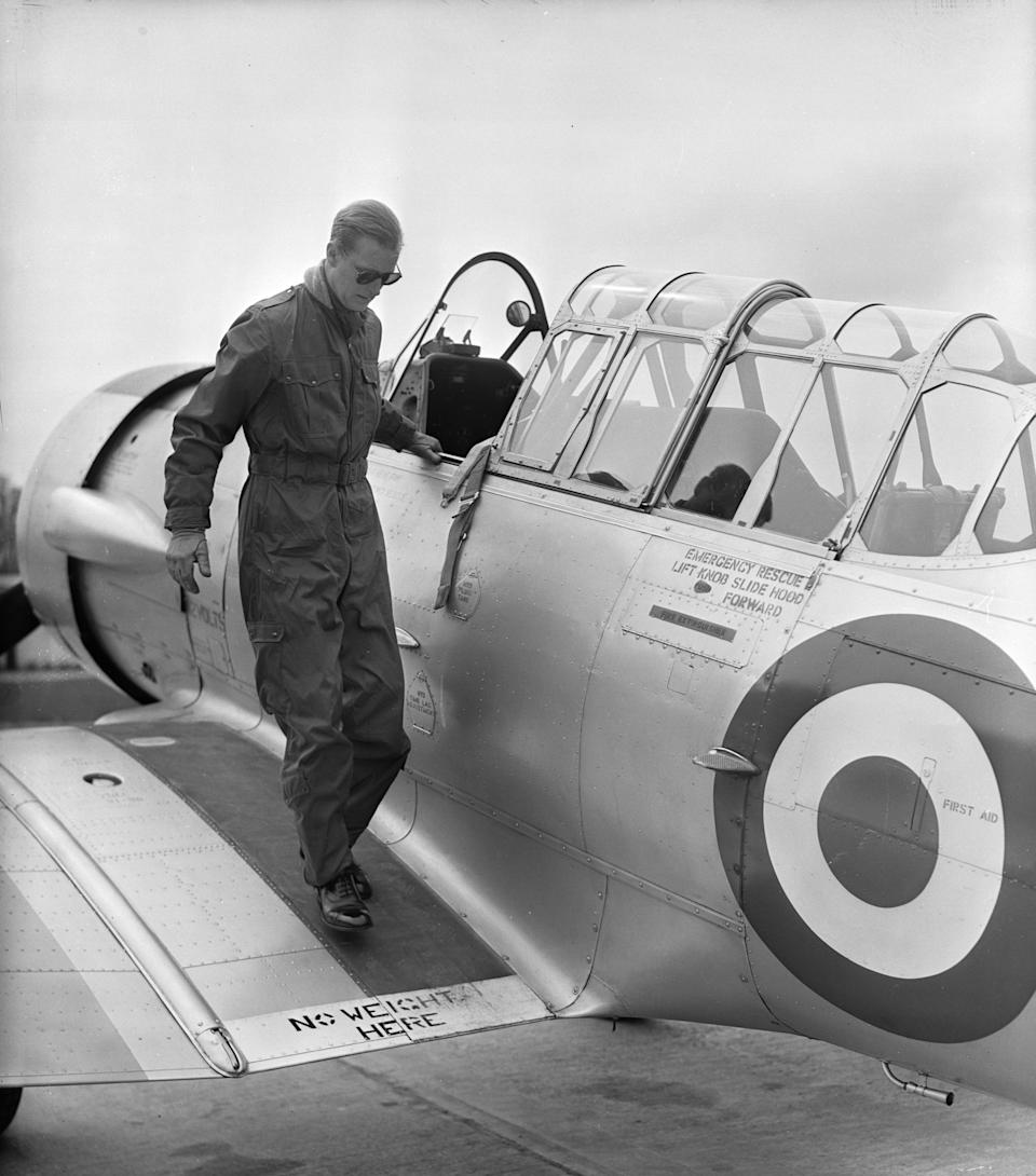 <p>Philip went all <em>Top Gun</em> in overalls and aviator shades while training for his 'wings' in May 1953. Photo: Getty Images.</p>