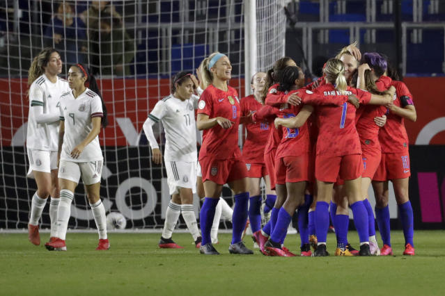 U.S. players celebrate a goal by midfielder Samantha Mewis during the second half of a CONCACAF women's Olympic qualifying soccer match against Mexico on Friday, Feb. 7, 2020, in Carson, Calif. (AP Photo/Chris Carlson)