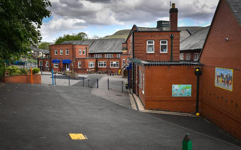 An empty playground at Milton St. John's Primary School which has been forced to close for a risk assessment by Public Health England after a confirmed case of COVID-19 was reported on May 22, 2020 in Mossley, United Kingdom -Councils could be told to 'justify their actions' if they refuse to reopen primary schools next week - GETTY IMAGES