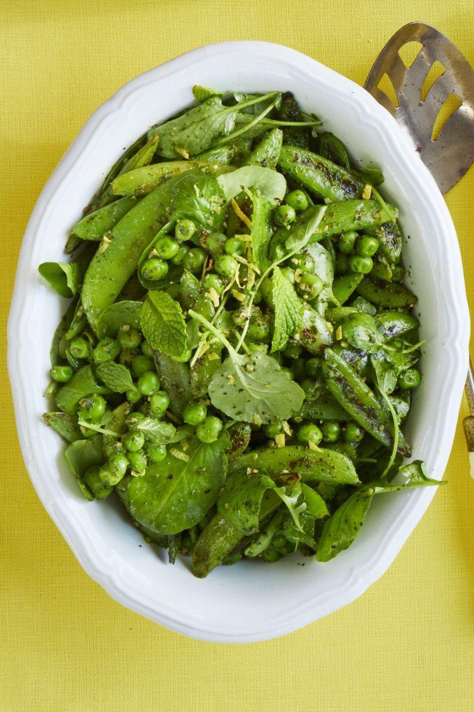 """<p>The secret to this flavor-packed recipe? A searing-hot cast iron skillet.</p><p><em><a href=""""https://www.womansday.com/food-recipes/food-drinks/a19122134/blistered-pea-salad-with-mint-pesto-recipe/"""" rel=""""nofollow noopener"""" target=""""_blank"""" data-ylk=""""slk:Get the recipe from Woman's Day »"""" class=""""link rapid-noclick-resp"""">Get the recipe from Woman's Day »</a></em></p>"""