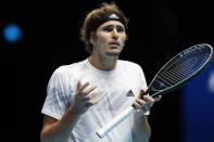 Alexander Zverev of Germany reacts as he plays against Novak Djokovic of Serbia during their singles tennis match at the ATP World Finals tennis tournament at the O2 arena in London, Friday, Nov. 20, 2020. (AP Photo/Frank Augstein)