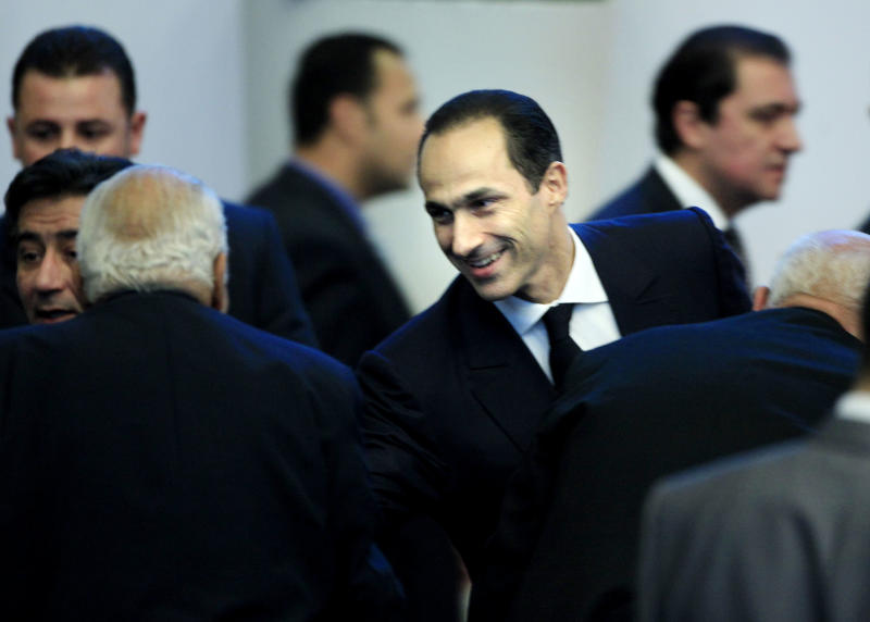 Gamal Mubarak, the son of Egyptian President Hosni Mubarak greets attendences of the sessions of the 7th Annual Conference of the National Democratic Party in Cairo, Egypt, Saturday, Dec.25, 2010. It is not yet officially announced whether the 82-year old Mubarak, in office since 1981, will run again for office. There were reports that he may be grooming his son for presidency.  (AP Photo/Amr Nabil)
