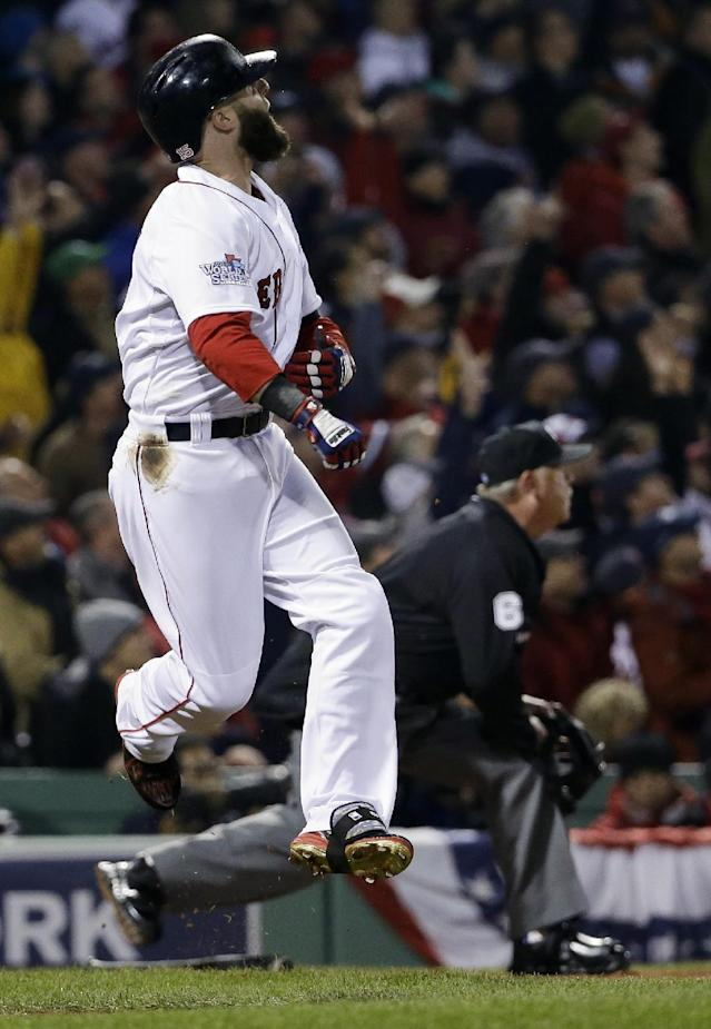 Boston Red Sox's Dustin Pedroia reacts as his long fly ball goes foul during the first inning of Game 6 of baseball's World Series against the St. Louis Cardinals Wednesday, Oct. 30, 2013, in Boston. (AP Photo/David J. Phillip)