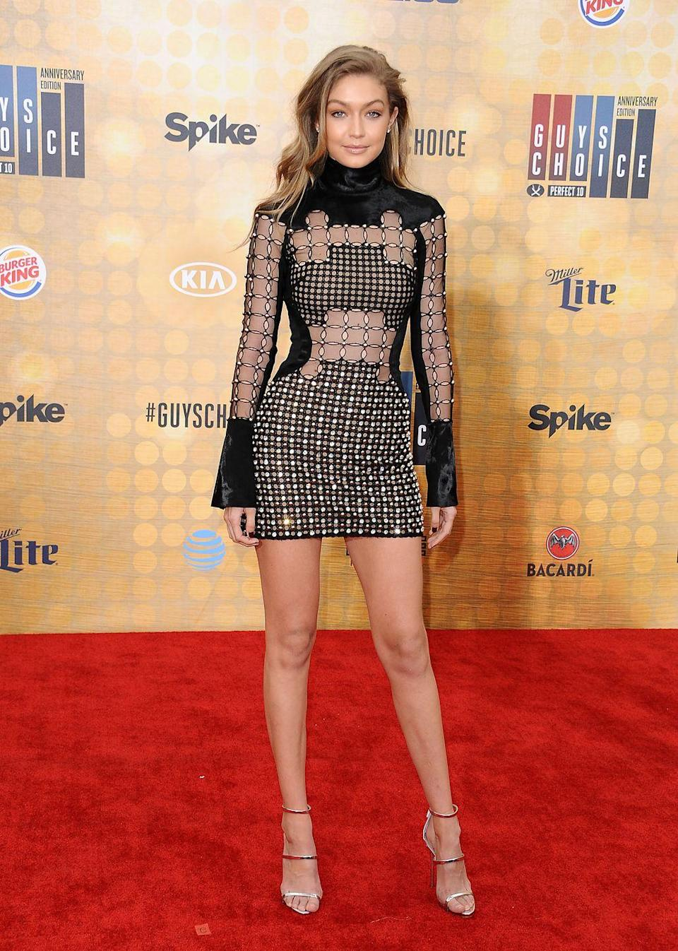 """<p>Even wearing a dress full of holes, Hadid looks chic while attending the <a href=""""https://www.harpersbazaar.com/celebrity/latest/g7368/guys-choice-awards-red-carpet-best-looks/"""" rel=""""nofollow noopener"""" target=""""_blank"""" data-ylk=""""slk:Spike TV Guys Choice Awards"""" class=""""link rapid-noclick-resp"""">Spike TV Guys Choice Awards</a>. </p>"""