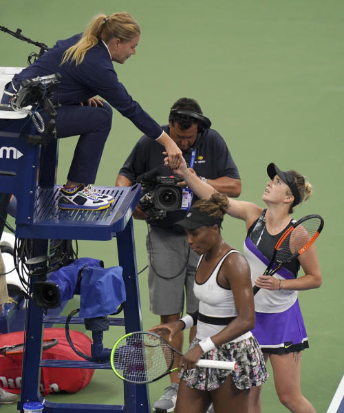Elina Svitolina, of Ukraine, greets the chair umpire after defeating Venus Williams, of the United States, in the second round of the US Open tennis championships Wednesday, Aug. 28, 2019, in New York. (AP Photo/Michael Owens)