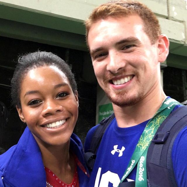 """<p>""""For the last 2 years he has encouraged & believed in me! #Rio2016 #MyCoach,"""" wrote Gabby Douglas with this photo of her and coach Christian Gallardo. (@gabrielledoug/Twitter) </p>"""