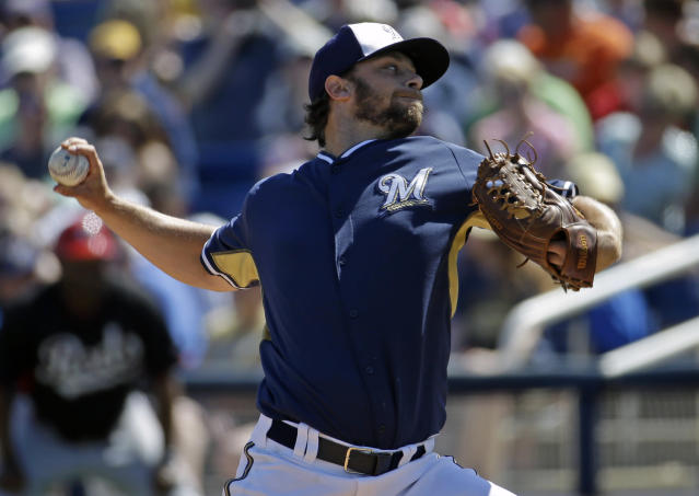 Milwaukee Brewers' Tyler Thornburg throws during the first inning of an exhibition spring baseball game against the Cincinnati Reds, Saturday, March 15, 2014, in Phoenix. (AP Photo/Morry Gash)