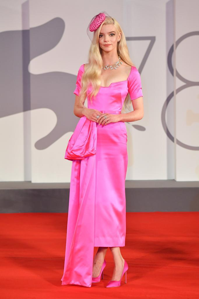 """<p>The blonde was pretty in pink Haute Couture Dior for the red carpet of the movie 'Last Night In Soho' while at the <a href=""""https://www.elle.com/uk/fashion/celebrity-style/g28853098/venice-film-festival-red-carpet/"""" rel=""""nofollow noopener"""" target=""""_blank"""" data-ylk=""""slk:Venice Film Festival"""" class=""""link rapid-noclick-resp"""">Venice Film Festival</a>. </p>"""