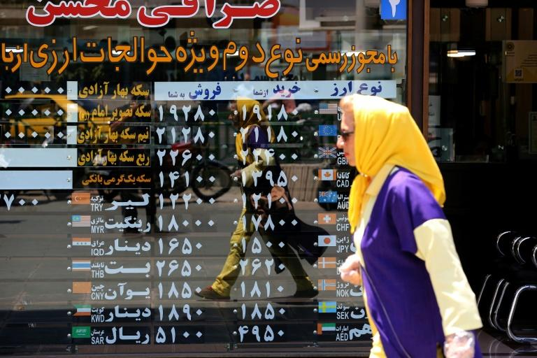 The economy in Iran, which is under US sanctions since 2018, deteriorated after it reported its first coronavirus cases in February (AFP Photo/ATTA KENARE)