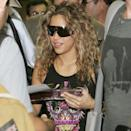 <p>Shakira signs autographs while she arrives at Miami International Airport in June 2005. </p>