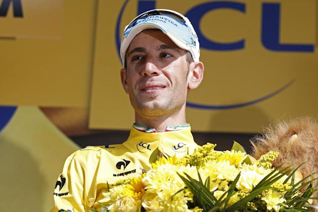 Italy's Vincenzo Nibali, wearing the overall leader's yellow jersey, celebrates on the podium of the twentieth stage of the Tour de France cycling race, an individual time-trial over 54 kilometers (33.6 miles) with start in Bergerac and finish in Perigueux, France, Saturday, July 26, 2014. (AP Photo/Christophe Ena)