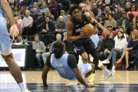 Orlando Magic's Wes Iwundu, center top, bowls over Minnesota Timberwolves' Naz Reid as he drives in the first half of an NBA basketball game, Friday, March 6, 2020, in Minneapolis. (AP Photo/Jim Mone)