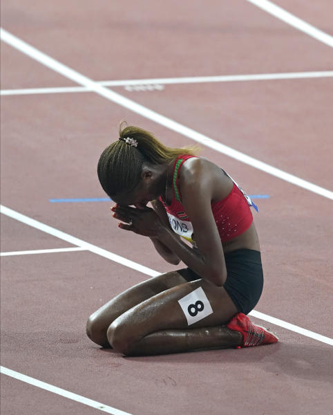 Beatrice Chepkoech, of Kenya, reacts after winning the the women's 3000 meter steeplechase final at the World Athletics Championships in Doha, Qatar, Monday, Sept. 30, 2019. (AP Photo/Nick Didlick)