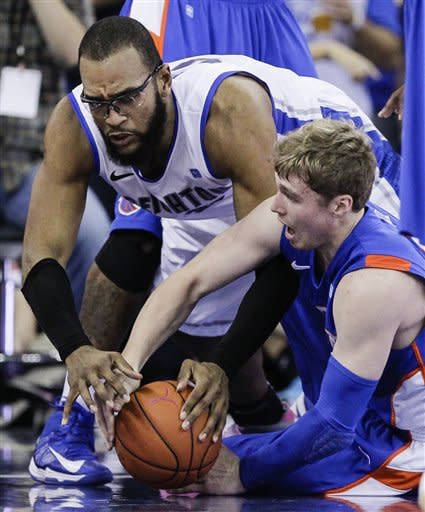 Boise State's Jeff Elorriaga, right, and Creighton's Gregory Echenique scramble for a loose ball during the first half of an NCAA college basketball game in Omaha, Neb., Wednesday, Nov. 28, 2012. (AP Photo/Nati Harnik)