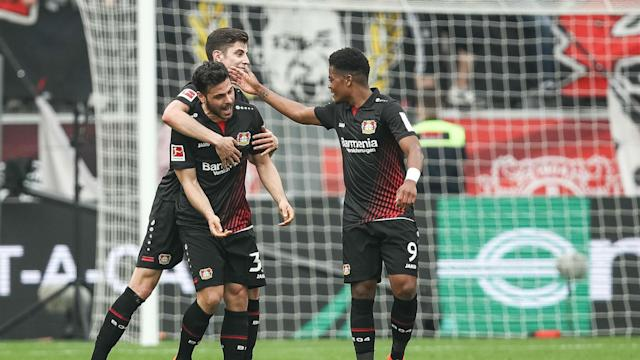 Kevin Volland grabbed a hat-trick to tighten Bayer Leverkusen's grip on the Bundesliga's fourth Champions League spot.