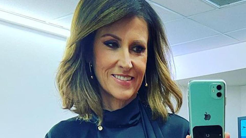 Sunrise host Nat Barr takes a selfie in front of a mirror