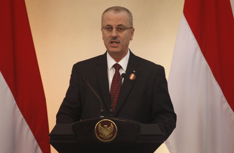 Palestinian Prime Minister Rami Hamdallah delivers his speech during the 2nd Conference on Cooperation among East Asian Countries for Palestinian Development (CEAPAD) in Jakarta, Indonesia, Saturday, March 1, 2014. (AP Photo/Achmad Ibrahim, Pool)