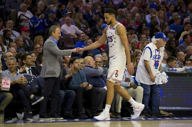 Ben Simmons -- seen here with Philadelphia 76ers owner Joshua Harris during an NBA playoff game against the Toronto Raptors -- has reportedly agreed to a five-year, $170 million contract extension with the club (AFP Photo/Mitchell Leff)