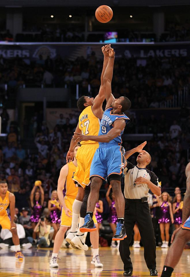LOS ANGELES, CA - MAY 19:  Andrew Bynum #17 of the Los Angeles Lakers and Serge Ibaka #9 of the Oklahoma City Thunder go after the opening jump ball to start Game Four of the Western Conference Semifinals in the 2012 NBA Playoffs on May 19 at Staples Center in Los Angeles, California. NOTE TO USER: User expressly acknowledges and agrees that, by downloading and or using this photograph, User is consenting to the terms and conditions of the Getty Images License Agreement.  (Photo by Stephen Dunn/Getty Images)