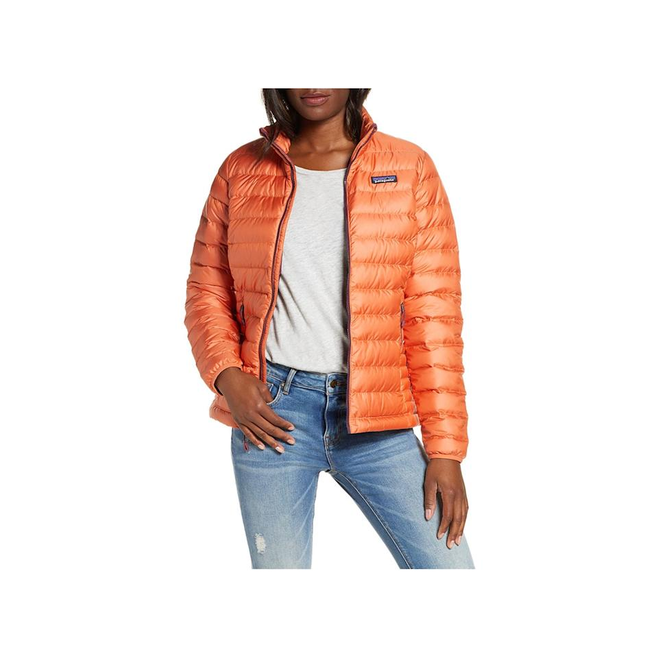 """Patagonia's down jacket is a classic for a reason: It's a warm yet lightweight piece (at just 12 ounces) that you can easily store in your bag or desk at work in case you need an extra layer. $229, Nordstrom. <a href=""""https://shop.nordstrom.com/s/patagonia-down-jacket/3921506"""">Get it now!</a>"""