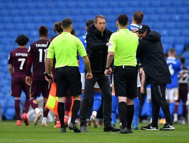 Graham Potter shakes hands with the officials