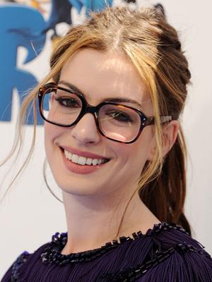 Hathaway was the talk of the town for wearing oversized geek chic spectacles on the blue carpet at the moview premier of Rio. Was she trying to make a fashion statement or was she really having contact lense issues?