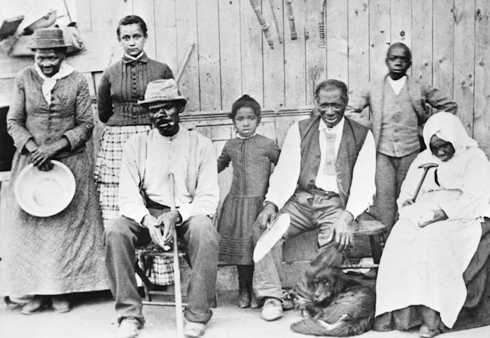 """<span class=""""caption"""">Tubman, left, with a few of the former slaves she helped escape. </span> <span class=""""attribution""""><a class=""""link rapid-noclick-resp"""" href=""""https://www.gettyimages.com/detail/news-photo/harriet-tubman-photographed-with-a-group-of-slaves-whose-news-photo/514885176"""" rel=""""nofollow noopener"""" target=""""_blank"""" data-ylk=""""slk:Bettmann/Getty Images"""">Bettmann/Getty Images</a></span>"""
