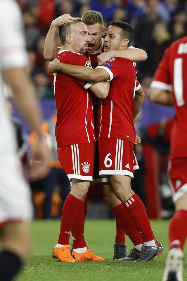 Bayern's Franck Ribery, left, celebrates with team mates Joshua Kimmich, center, and Thiago after scoring his side's opening goal during the Champions League quarter final first leg soccer match between Sevilla FC and FC Bayern Munich at the Sanchez Pizjuan stadium in Seville, Spain, Tuesday, April 3, 2018. (AP Photo/Miguel Morenatti)