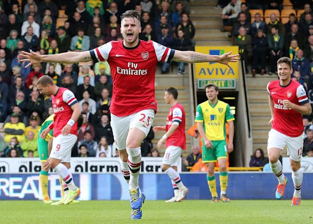 Arsenal's English defender Carl Jenkinson celebrates scoring during the English Premier League football match between Norwich City and Arsenal at Carrow Road on May 11, 2014 (AFP Photo/Lindsey Parnaby)