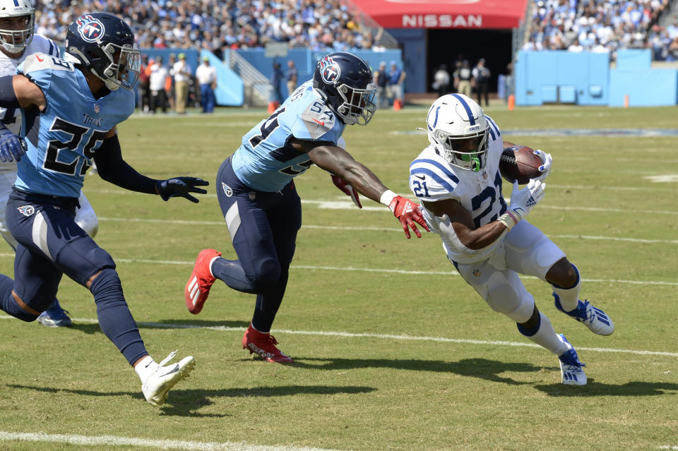 Indianapolis Colts running back Nyheim Hines (21) gets past Tennessee Titans inside linebacker Rashaan Evans (54) as Hines scores a touchdown in the first half of an NFL football game Sunday, Sept. 26, 2021, in Nashville, Tenn. (AP Photo/Mark Zaleski)