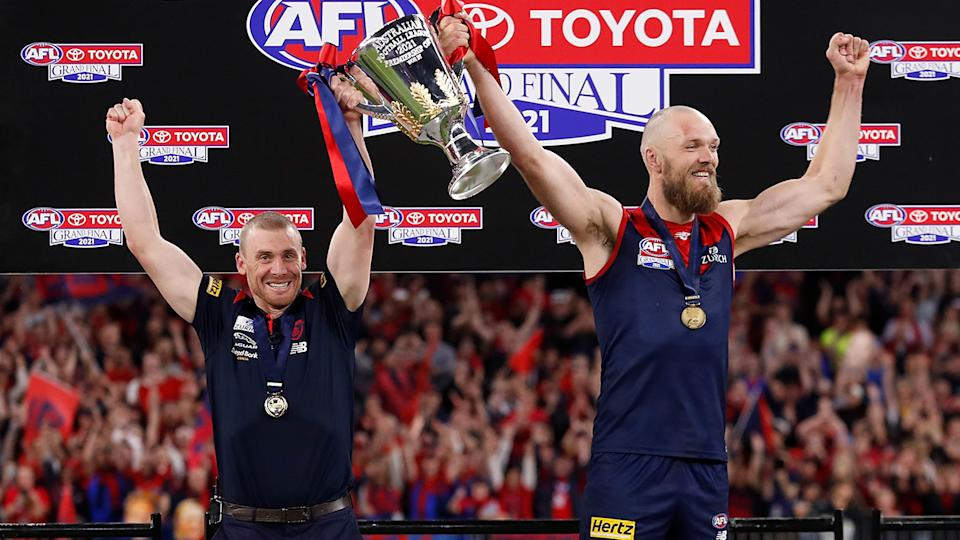 Despite missing out on a grand final speech, Melbourne coach Simon Goodwin was more than happy to raise the premiership cup with captain Max Gaw.. (Photo by Michael Willson/AFL Photos via Getty Images)