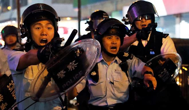 Police officers have often used their weapons in clashes with protesters, creating more animosity from the anti-government camp. Photo: Reuters