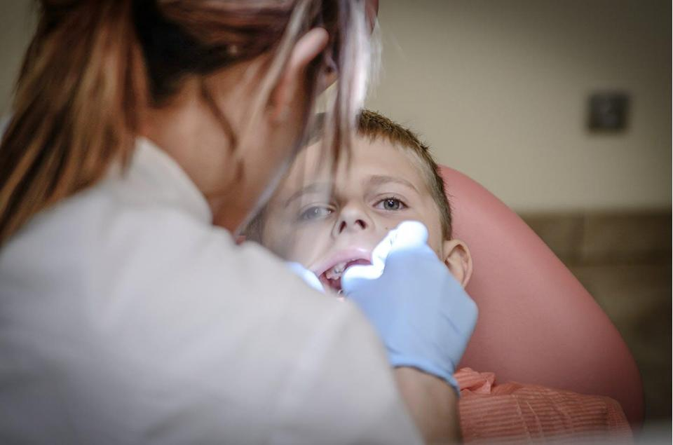A woman dentist and a child patient